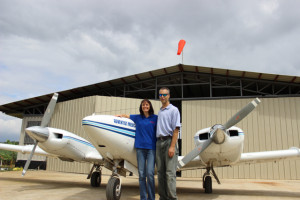 Dwayne and Wendy Harris in front of Luzon hangar