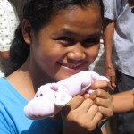 Joanne-sponsored student with new toy