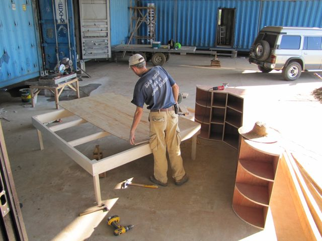 Andriy making kitchen cabinets and bed for hangar apartment ...