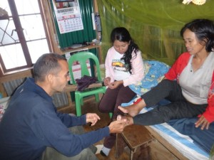Briane with patient in Tinoc that was healed