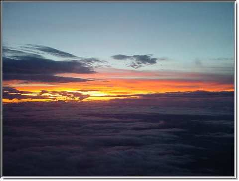 Sunrise over a sea of clouds above the jungles and savannahs of Venezuela